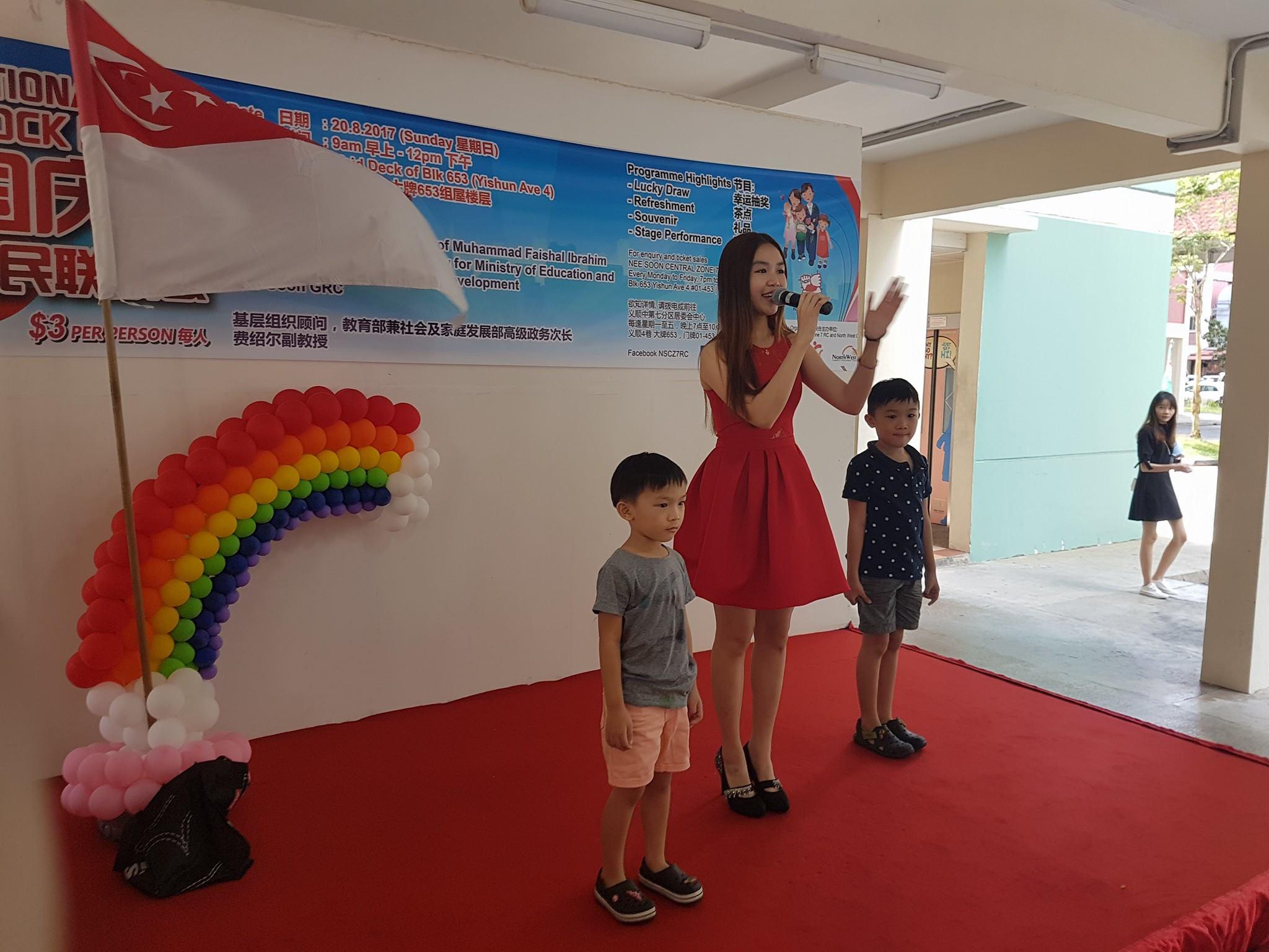 national day celebration emcee - anna singing on stage
